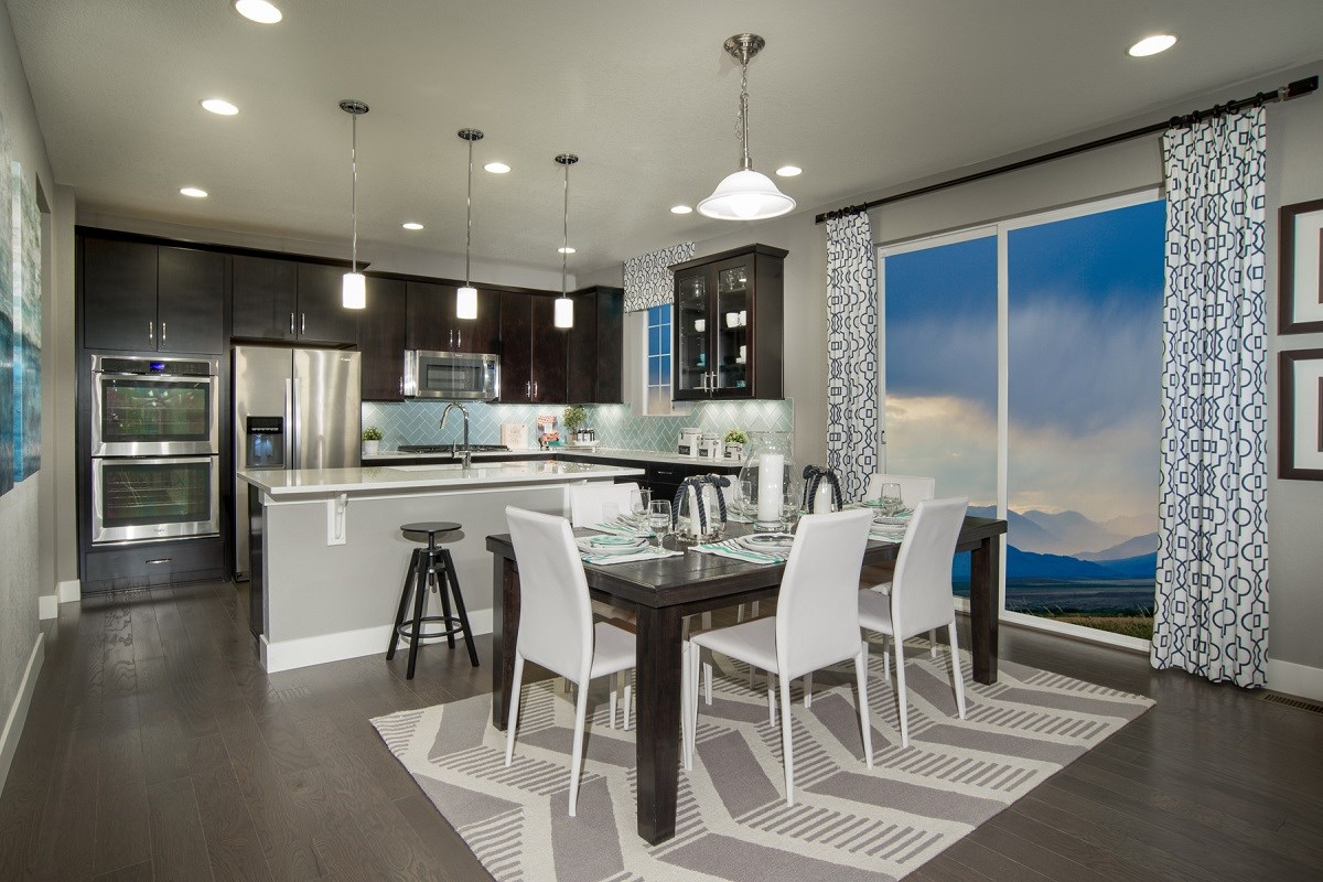 New Homes in Commerce City, CO - Reunion Loveland Dining Area and Kitchen