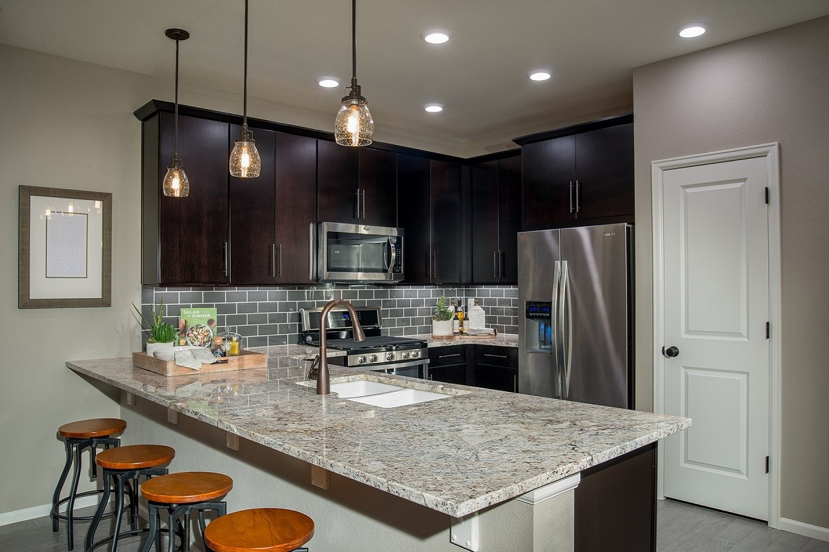 New Homes in Aurora, CO - Stapleton Villa Collection at Bluff Lake Maple Kitchen