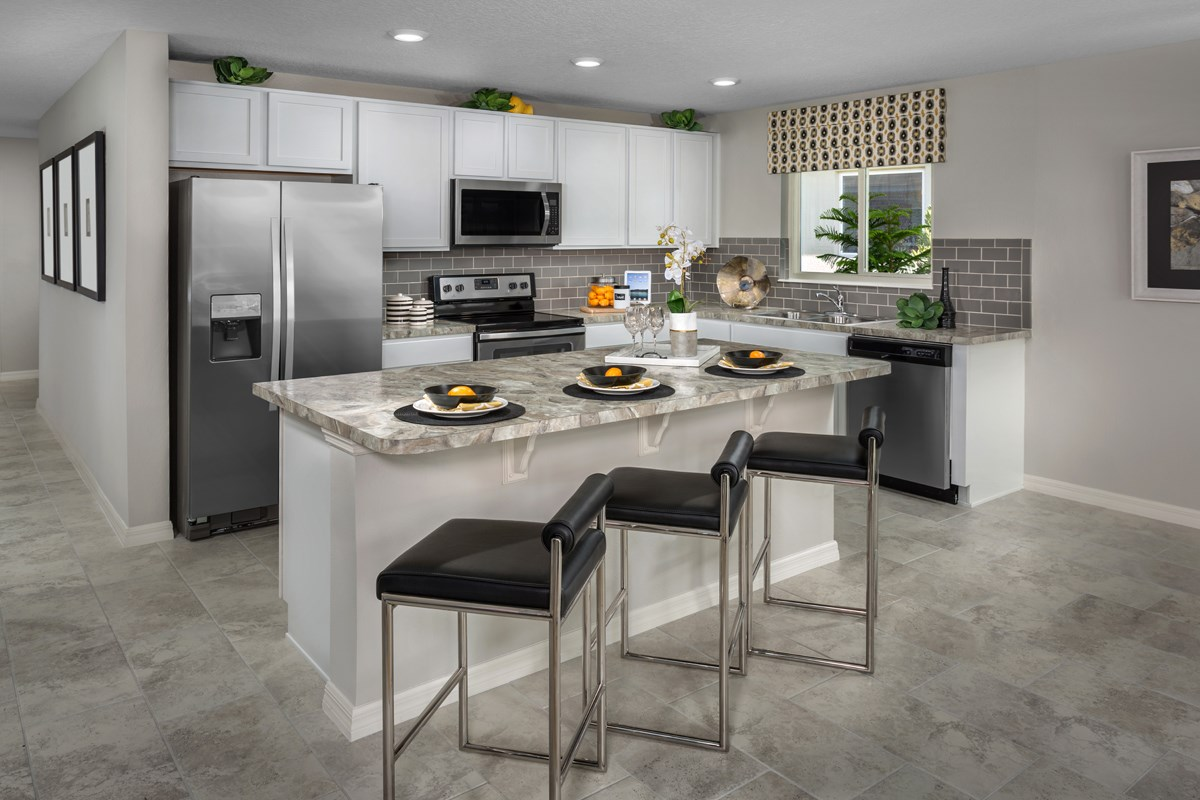 New Homes in Winter Haven, FL - Lake Lucerne 1707 Kitchen as modeled at Gramercy Farms