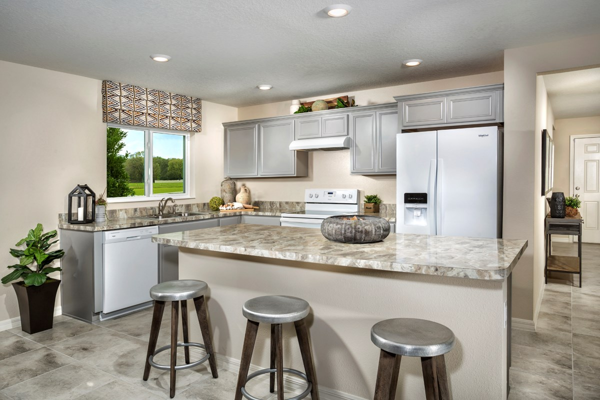 New Homes in Kissimmee, FL - Casa Bella Plan 1541 Kitchen as modeled at Cayden Reserve