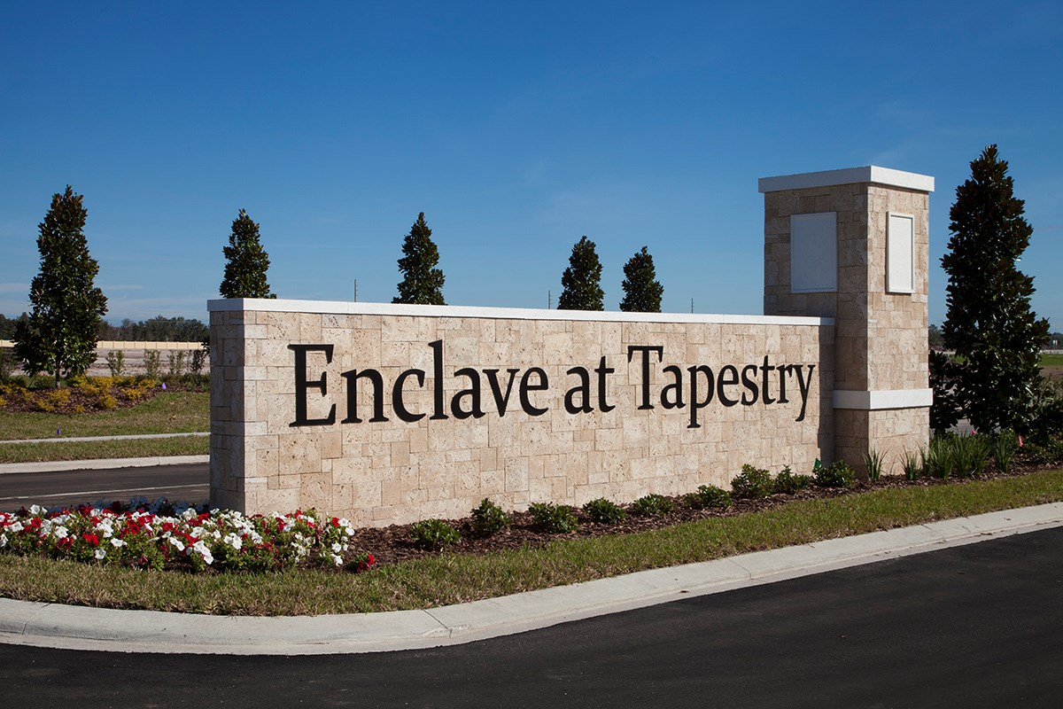 New Homes in Kissimmee, FL - Enclave at Tapestry Entry Wall
