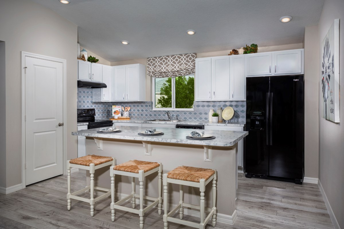 New Homes in Davenport, FL - Preservation Pointe 1511 Kitchen as modeled at Gramercy Farms II