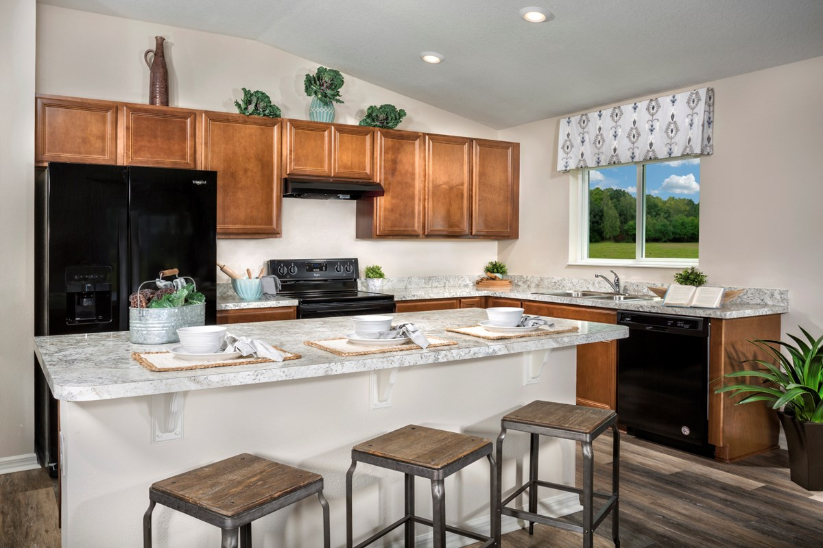 New Homes in Titusville, FL - Verona 1707 kitchen as modeled at Cayden Reserve