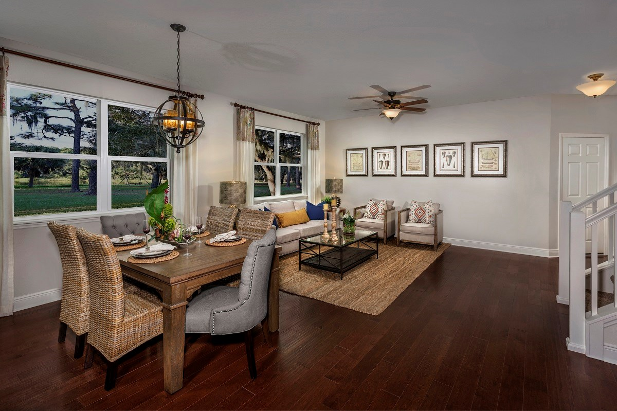 New Homes in Seminole, FL - Artisan Preserve Plan 2851 Dining and Living Room as modeled at Seminole Groves