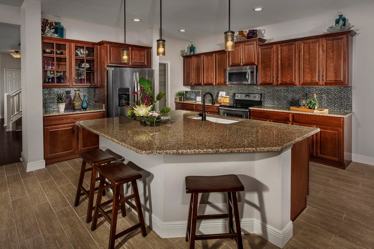 New Homes in Seminole, FL - Artisan Preserve Plan 2851 Kitchen as modeled at Seminole Groves
