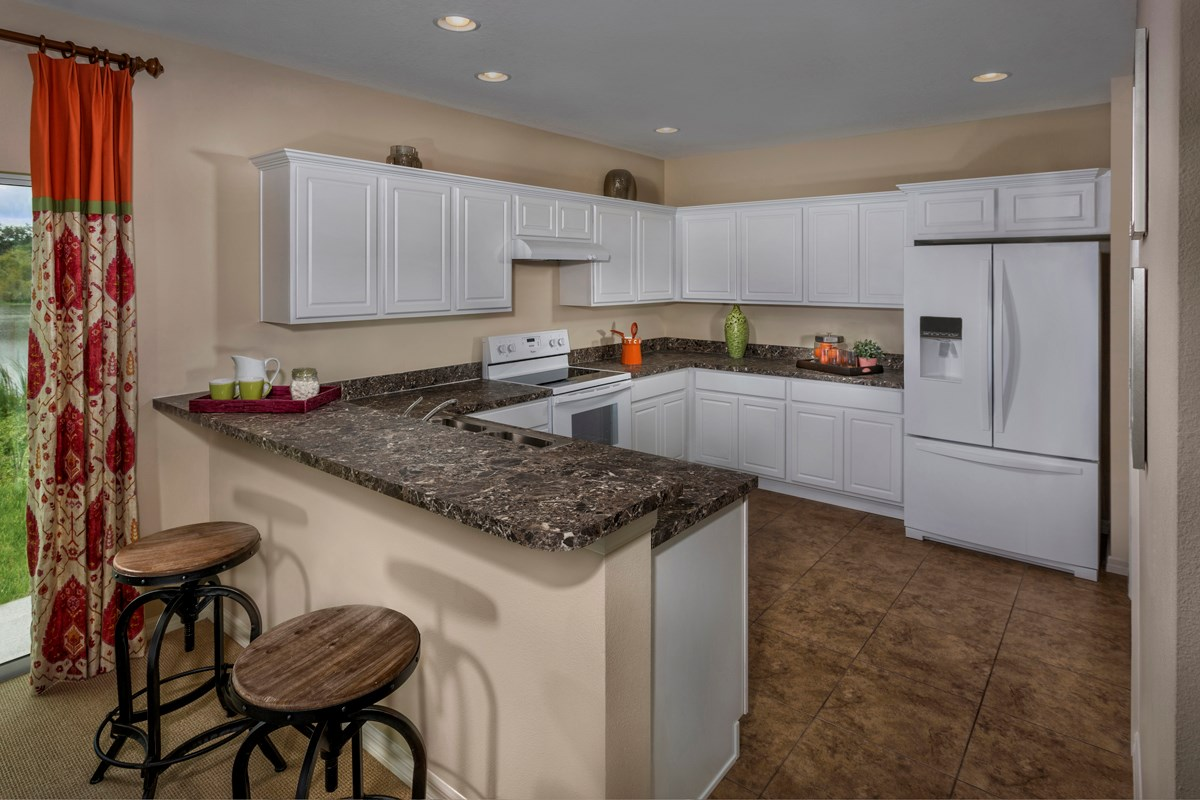 New Homes in Fort Myers, FL - Coves of Estero Bay Plan 1585 Kitchen as modeled at Medford Lakes