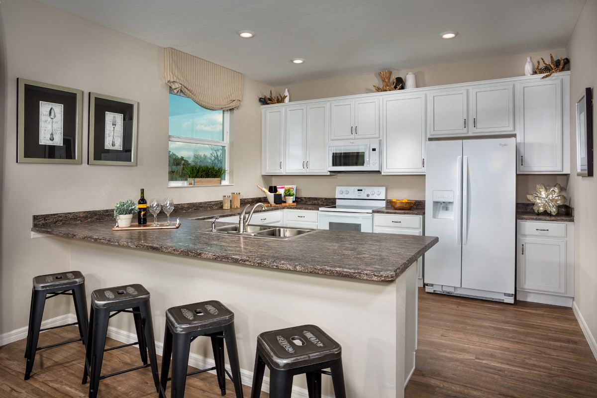 New Homes in Seminole, FL - Artisan Estates Plan 2294 Kitchen as modeled at Medford Lakes I