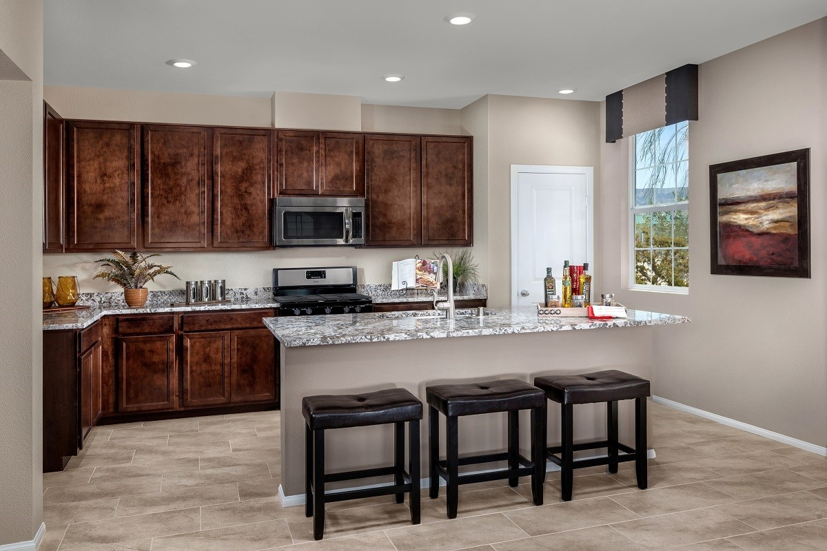 design a new home. New Homes in Henderson  NV Groves at Inspirada Plan 1843 Kitchen for Sale