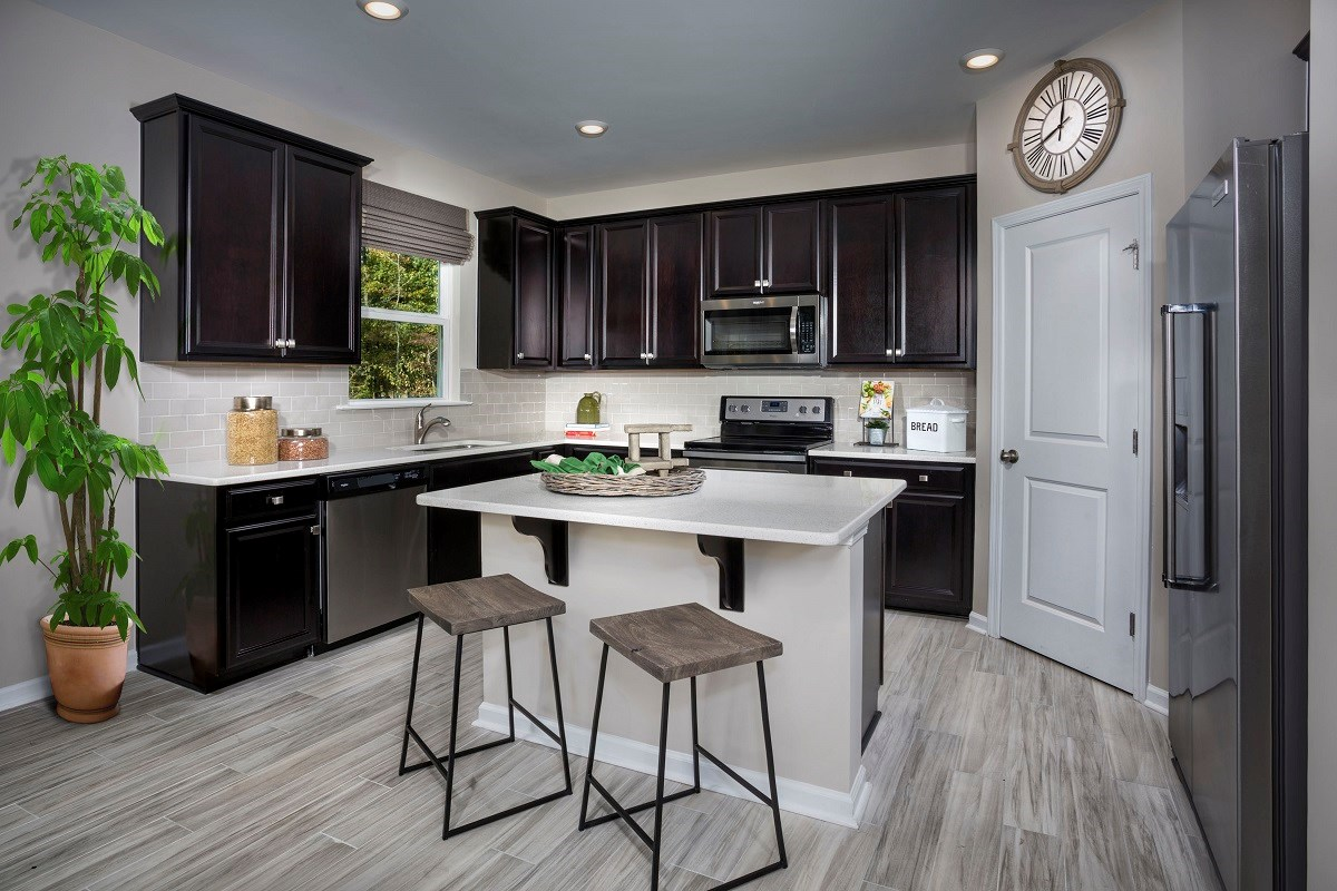New Homes in Fuquay-Varina, NC - Mason Pointe The Coltrane II Kitchen as modeled at Partin Place