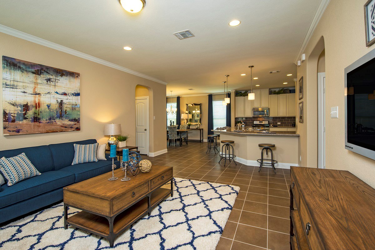 New Homes in Georgetown, TX - Creekside at Georgetown Village Plan E-1647 Great Room and Kitchen