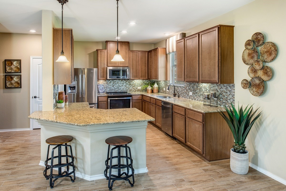 New Homes in Uhland, TX - Highlands at Grist Mill Plan F-1909 Kitchen as modeled at Greenlawn Village