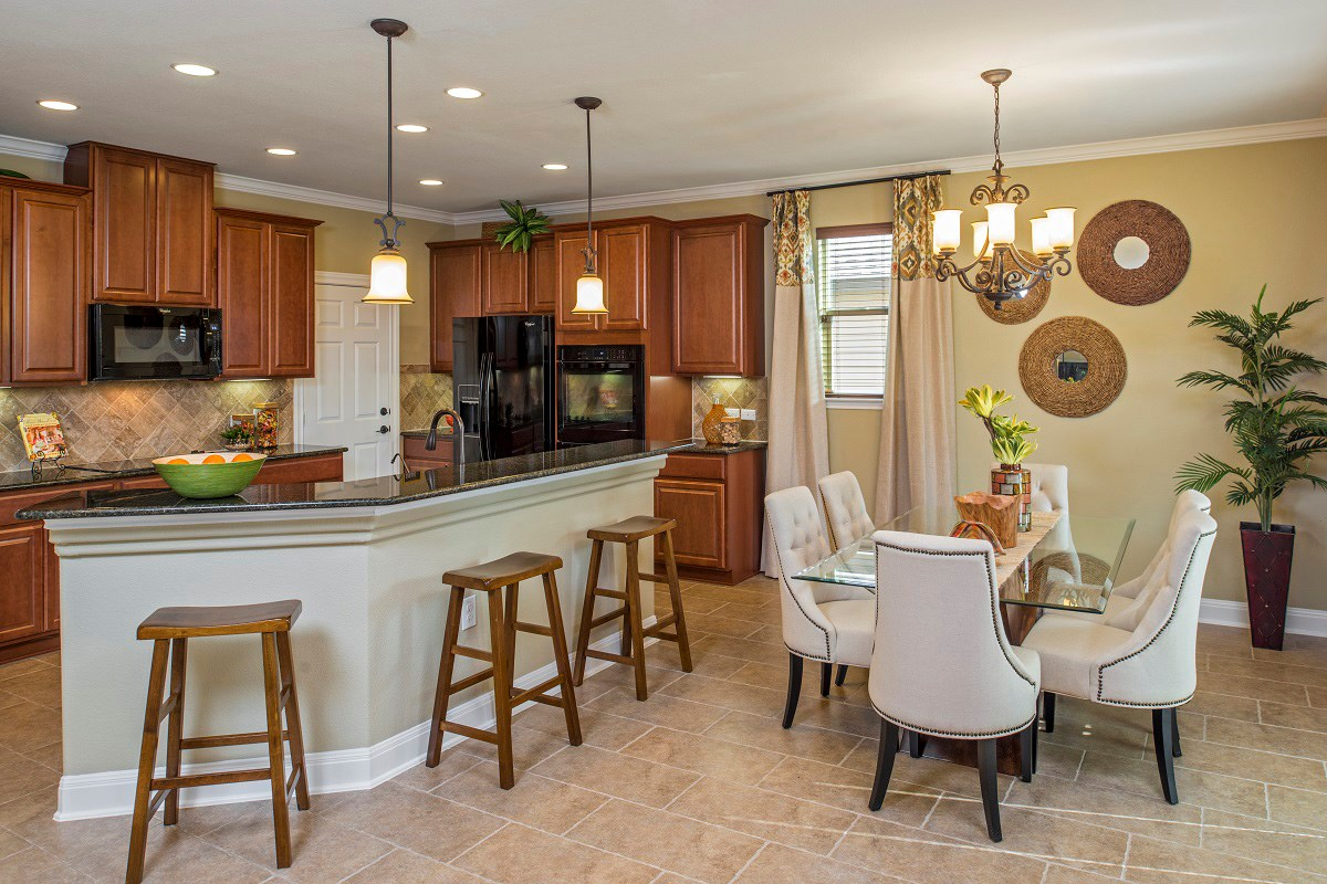 New Homes in Del Valle, TX - The Trails at Stoney Ridge Plan E-2403 Kitchen and Dining Area