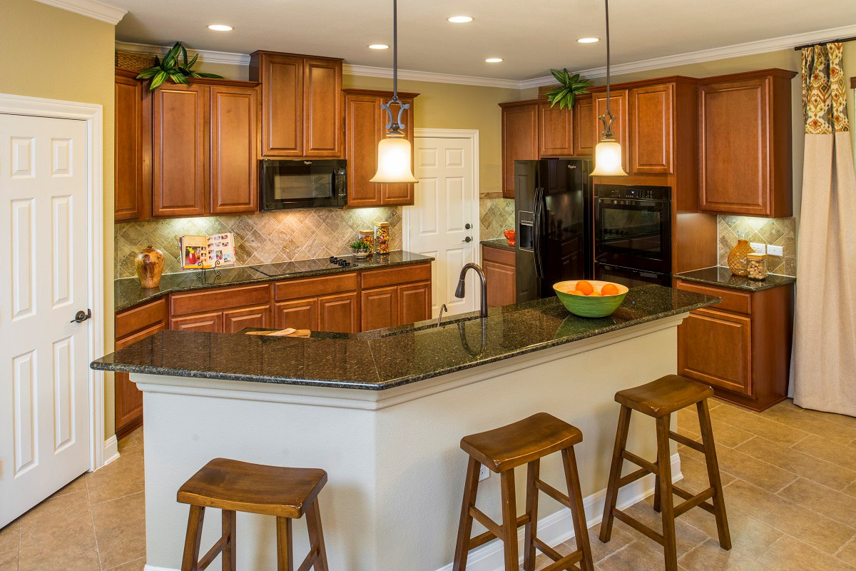 New Homes in Del Valle, TX - The Trails at Stoney Ridge Plan E-2403 Kitchen