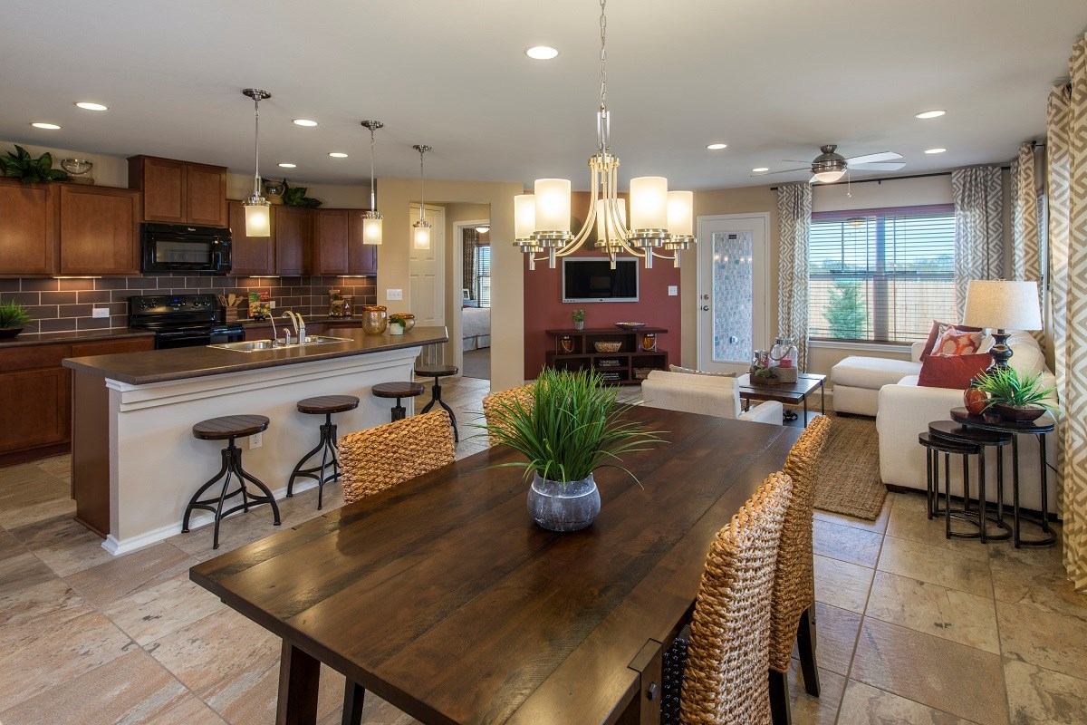 New Homes in Del Valle, TX - The Trails at Stoney Ridge Plan E-1694 Dining, Living and Kitchen