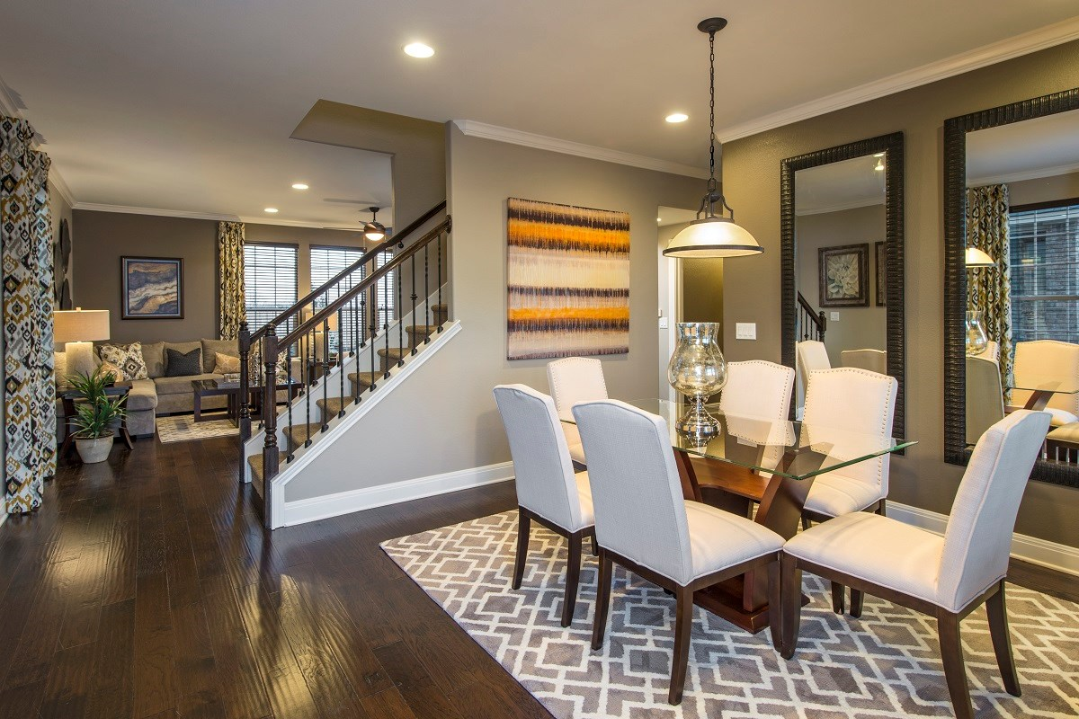 New Homes in Del Valle, TX - The Trails at Stoney Ridge Plan E-2177 Dining Area and Living Area