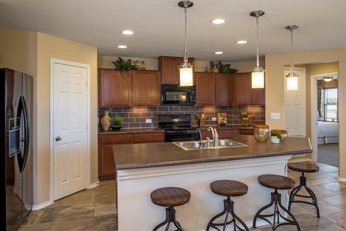 New Homes in Del Valle, TX - The Trails at Stoney Ridge Plan E-1694 Kitchen