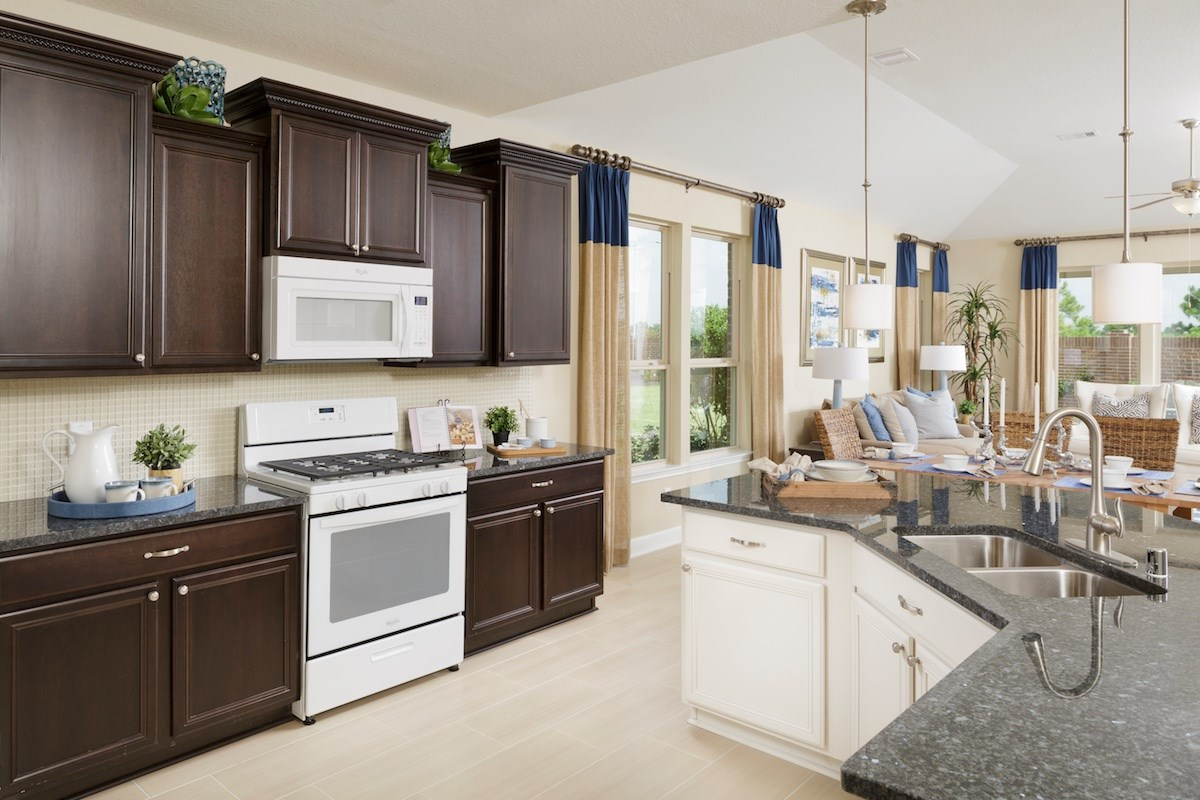 New Homes in Conroe, TX - Wedgewood Falls Preserve Plan 2130 Kitchen as modeled at Shadow Grove