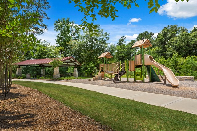 Park, playground and pavilion at KB Home community in Magnolia, TX