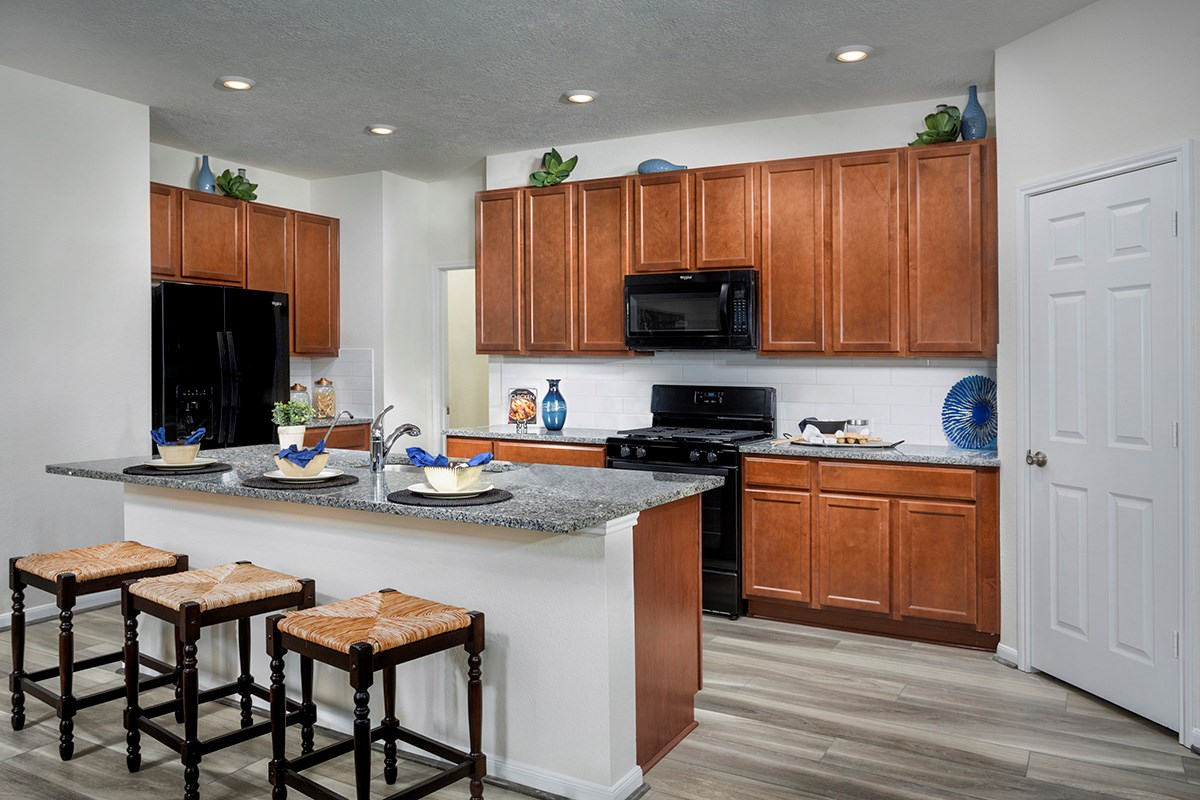 New Homes in Magnolia, TX - Cimarron Creek Preserve Plan 1631 Kitchen