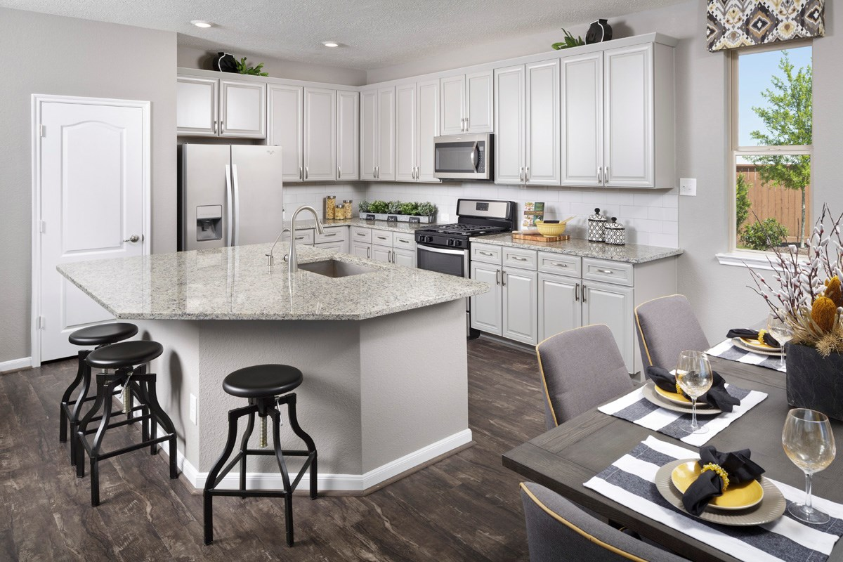 New Homes in Houston, TX - Mills Creek Crossing Plan 2646 Kitchen as modeled at Katy Manor Trails