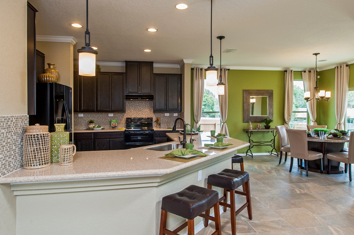 New Homes in San Antonio, TX - Ironwood at Crestway The 1647 Kitchen and Dining Room