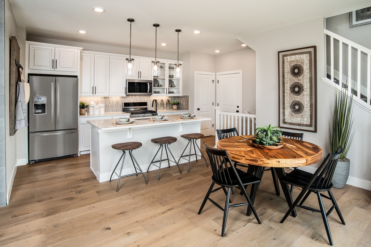 New Homes in Erie, CO - Flatiron Meadows Villas Plan 1671 Dining Room & Kitchen