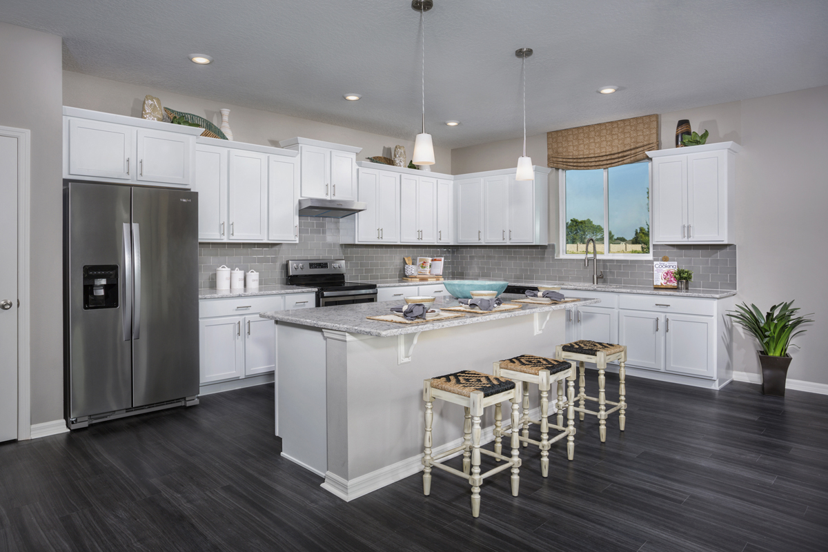 New Homes in Clermont, FL - Lake Minneola Landings 2342 kitchen as modeled at Carriage Hill
