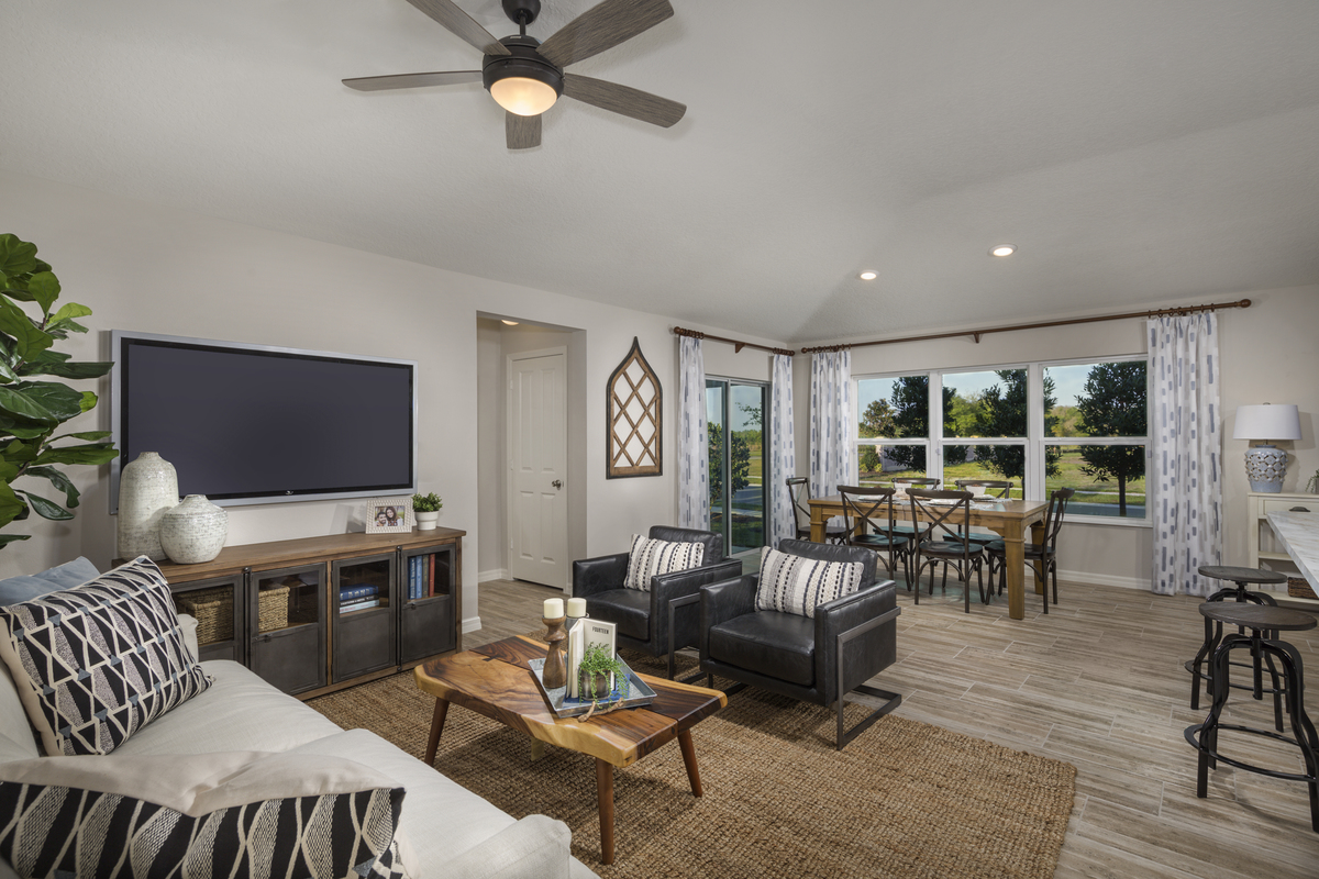 New Homes in Sanford, FL - Landings at Riverbend 1637 great room as modeled at Gramercy Farms