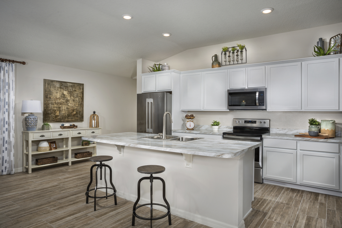 New Homes in Sanford, FL - Landings at Riverbend 1637 kitchen as modeled at Gramercy Farms