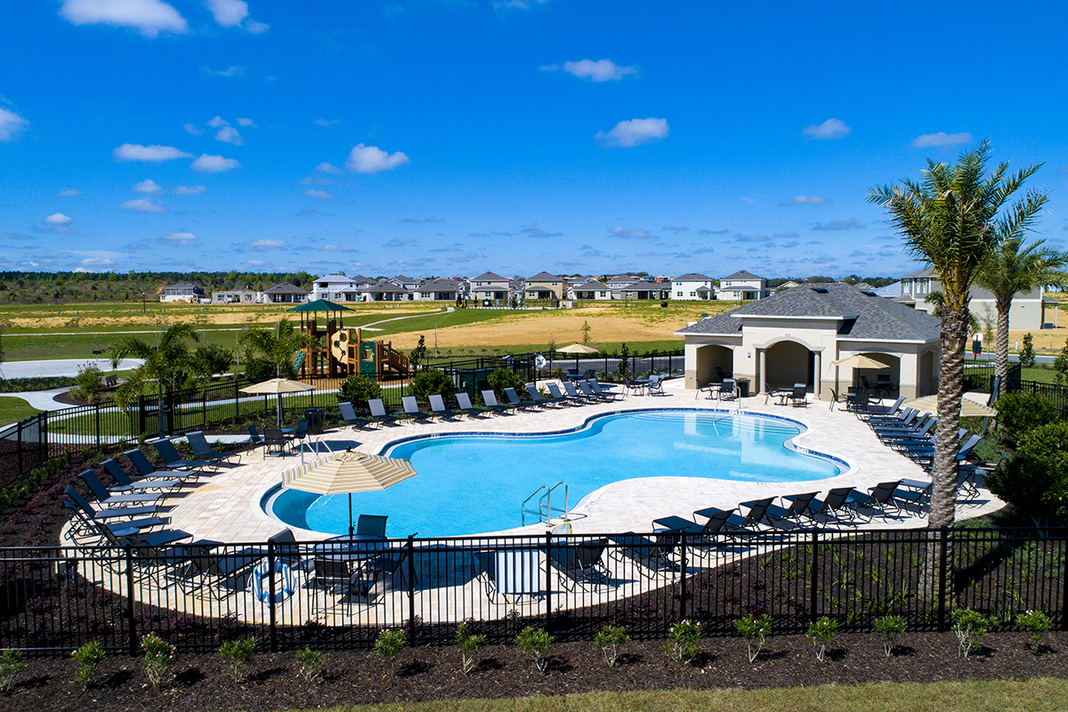 Amenity pool and tot lot at a KB Home community in Davenport, FL