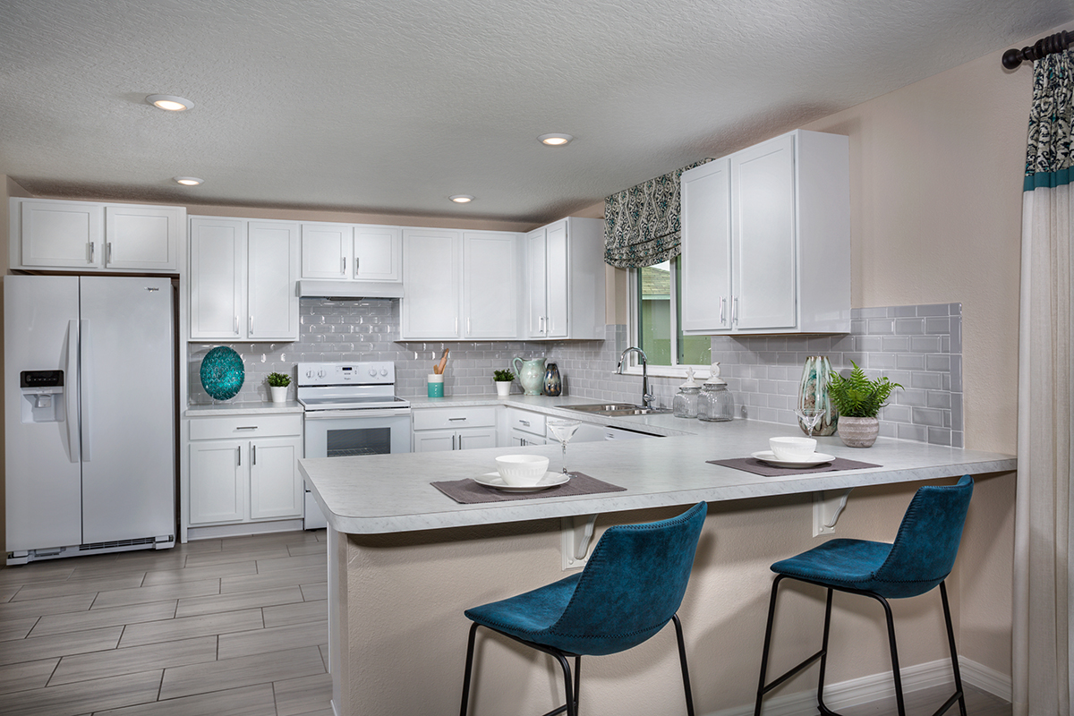 New Homes in Clermont, FL - The Sanctuary I Plan 2107 Kitchen as modeled at Preservation Pointe