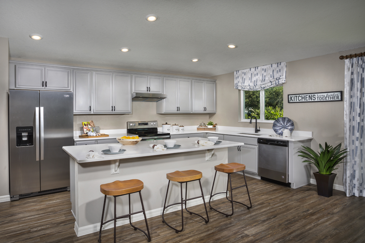 New Homes in Minneola, FL - The Reserve at Lake Ridge 2178 kitchen as modeled at Lake Minneola Landings