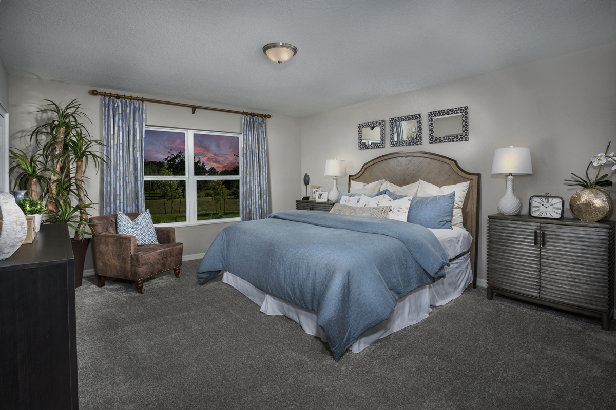 New Homes in Minneola, FL - The Reserve at Lake Ridge 2178 master bedroom as modeled at Lake Minneola Landings