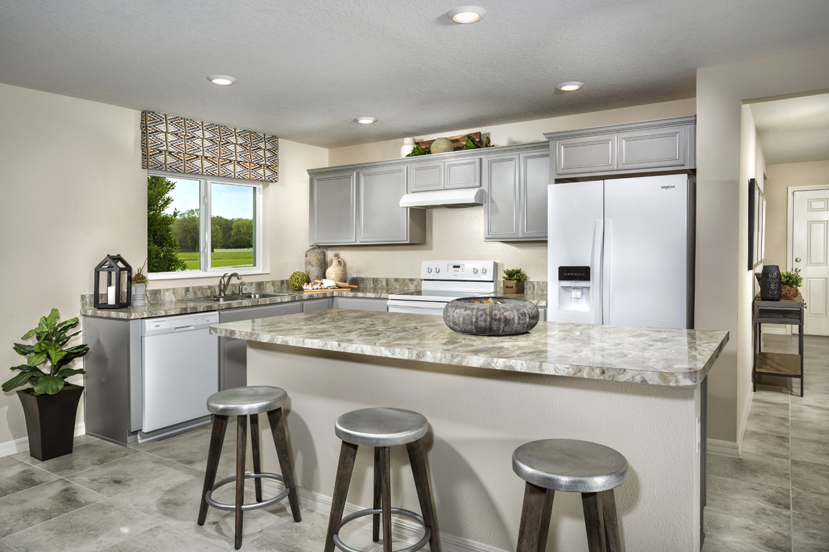 New Homes in Haines City, FL - Summerlin Groves 1541 kitchen as modeled at Cayden Reserve
