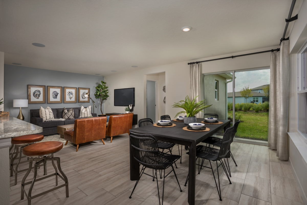 New Homes in Palmetto, FL - Heron Bay Plan 1637 Great Room as modeled at Brightwood at North River Ranch