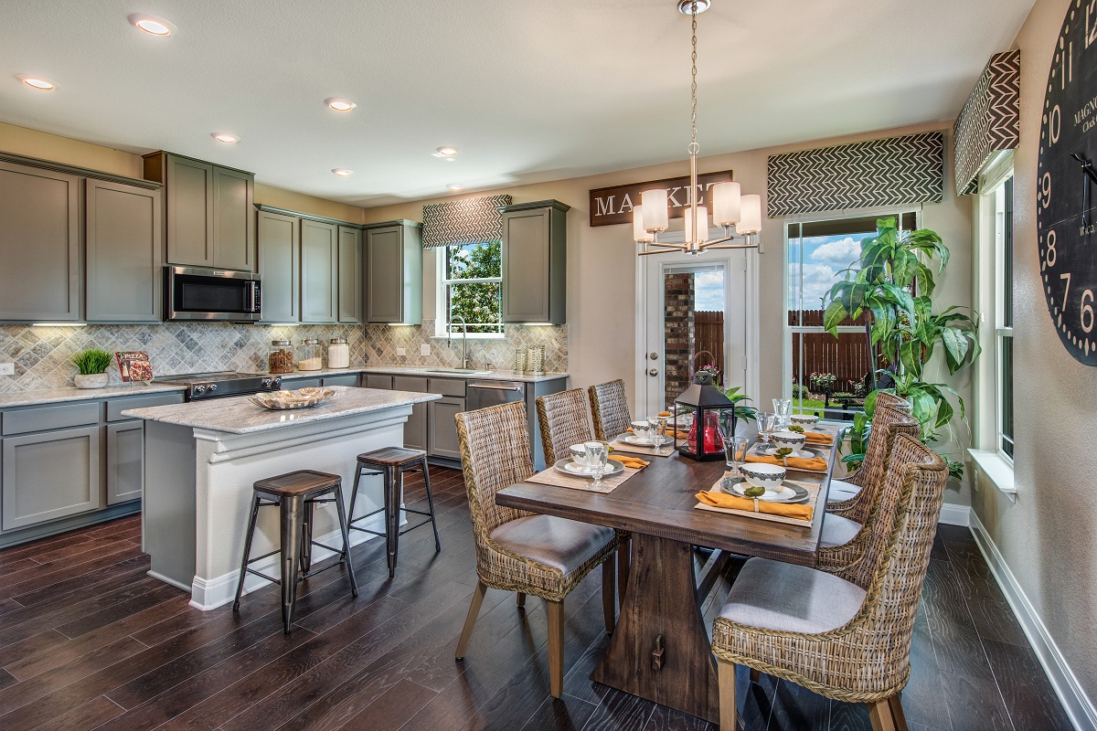 New Homes in Round Rock, TX - Greenlawn Village Plan F-2495 Kitchen and Dining Area