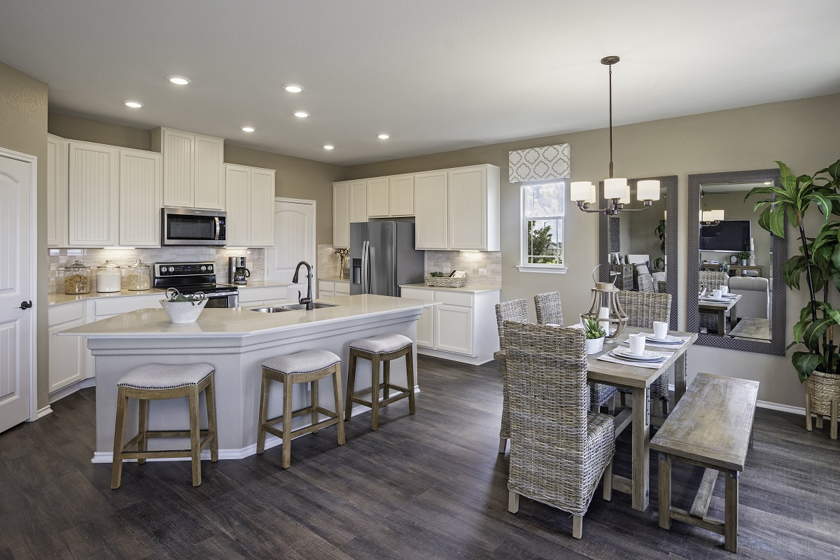New Homes in Elgin, TX - Saratoga Farms Plan E-2403 Kitchen and Dining Area