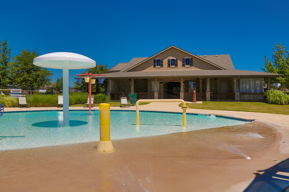 Pool with splash pad at a KB Home community in Fort Worth, TX