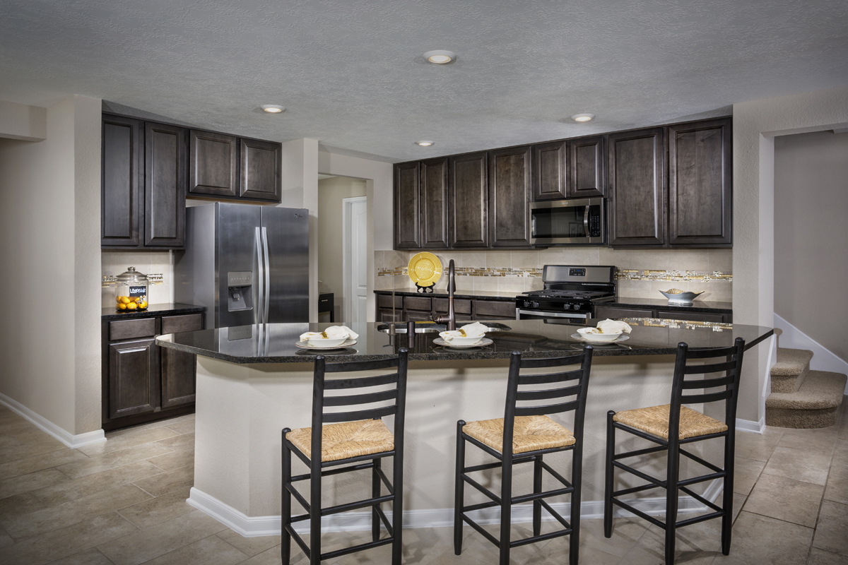 New Homes in La Marque, TX - Sunset Grove Plan 2936 Kitchen as modeled at Anserra Preserve