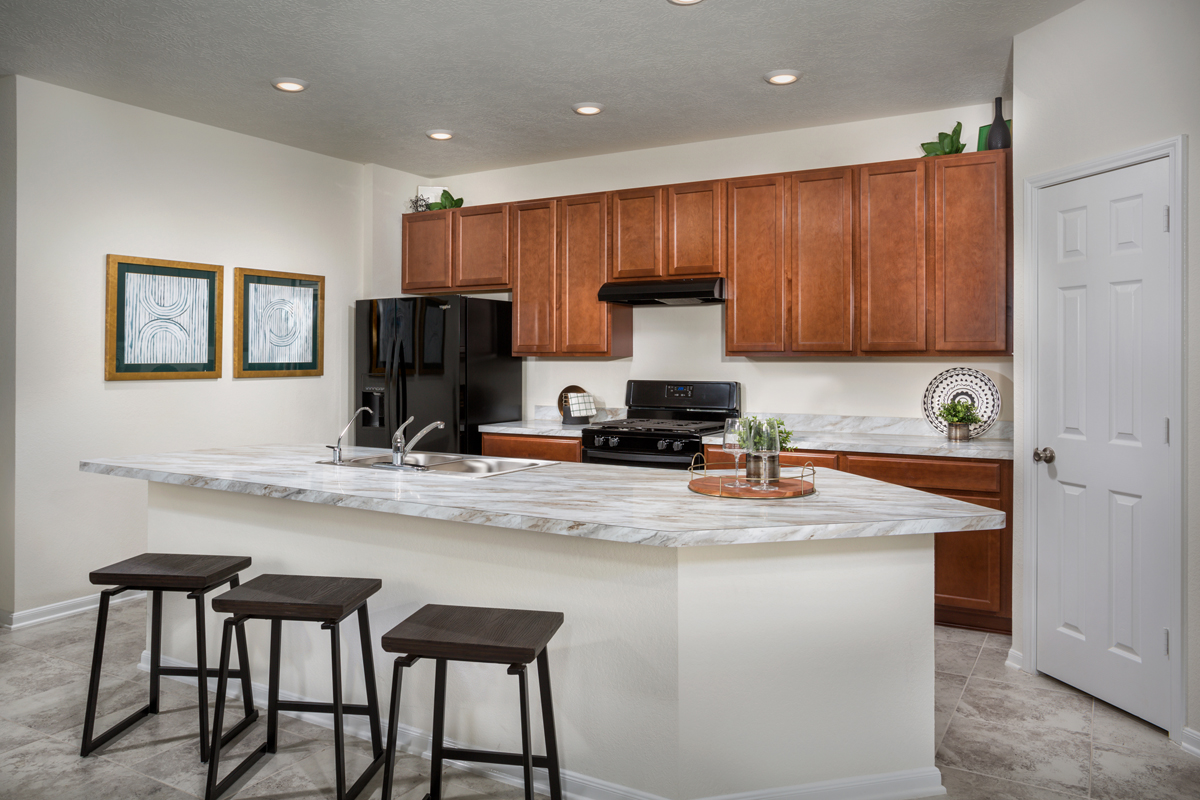 New Homes in Texas City, TX - Vida Costera Plan 1889 Kitchen as modeled at Cypress Creek Landing