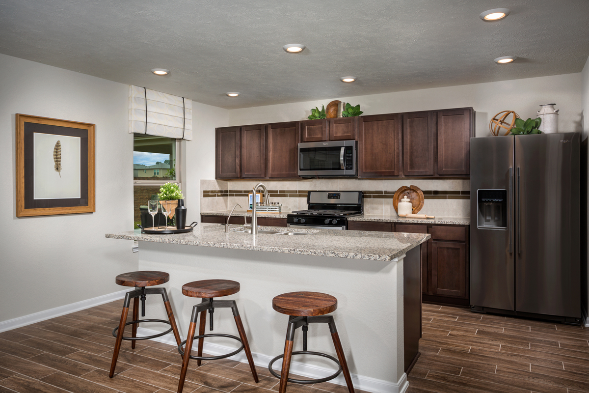 New Homes in Texas City, TX - Vida Costera Plan 2372 Kitchen as modeled at Cypress Creek Landing