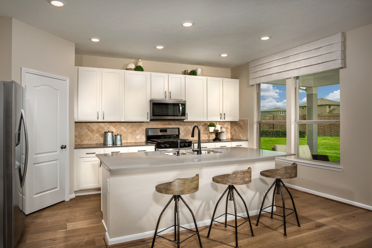 New Homes in Texas City, TX - Vida Costera Plan 2596 Kitchen as modeled at Cypress Creek Landing