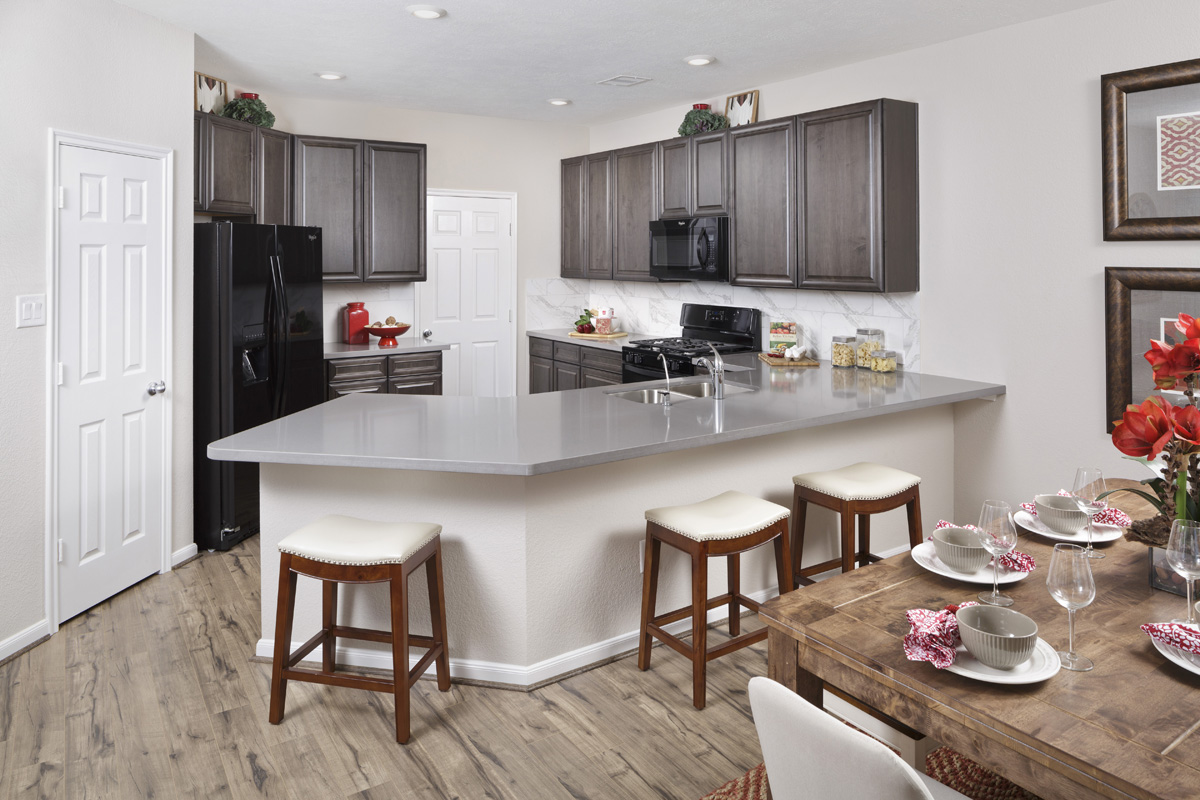 New Homes in Houston, TX - Lakewood Pines Trails Plan 1864 Kitchen as modeled at Katy Manor Trails