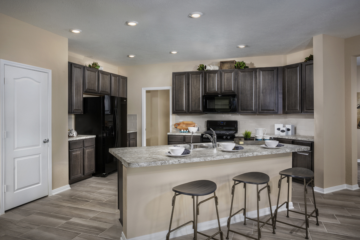 New Homes in Katy, TX - Anserra Springs Plan 2526 Kitchen as modeled at The Meadows at Westfield Village