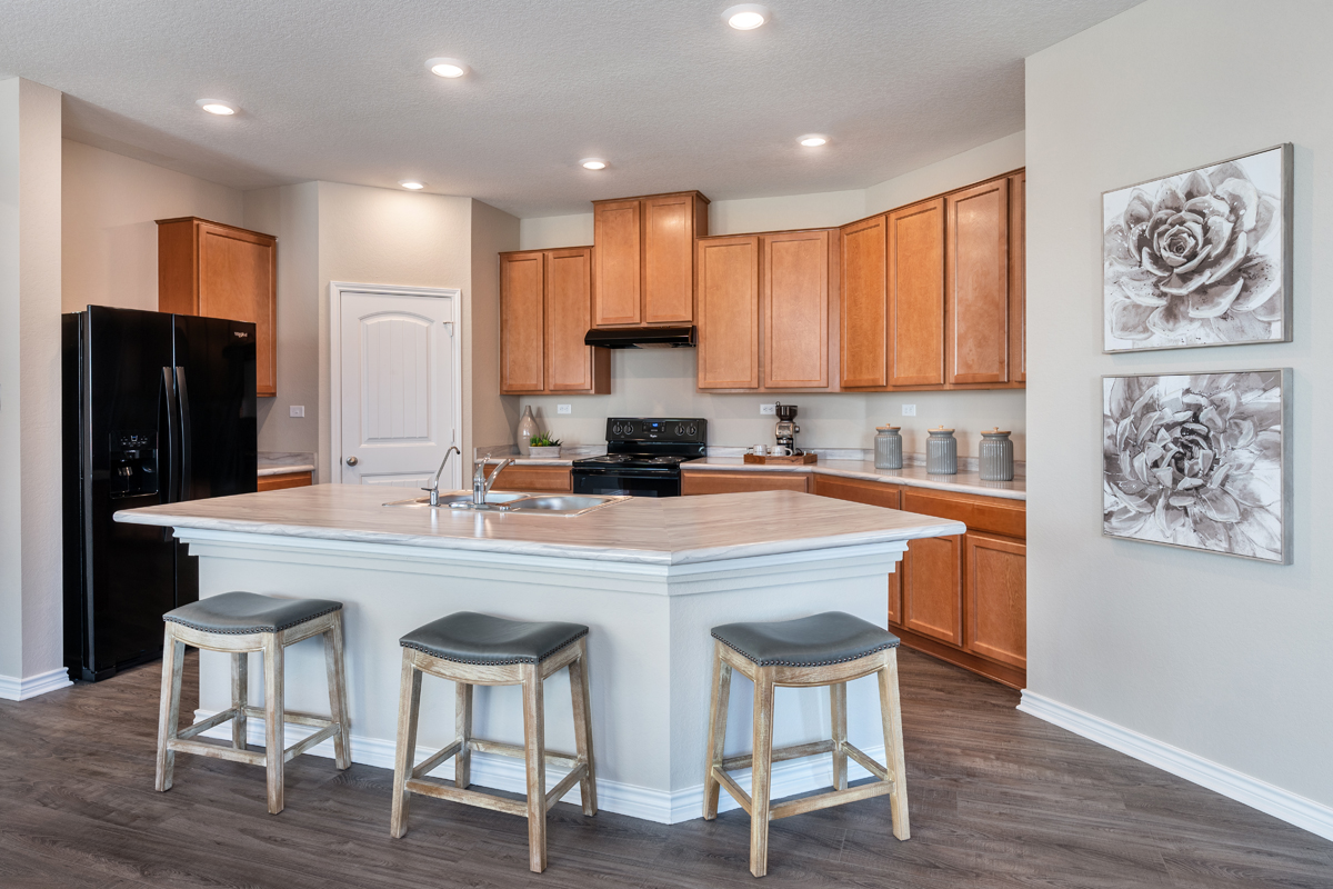 New Homes in San Antonio, TX - Falcon Landing Plan 1549 Kitchen as modeled at Deer Crest