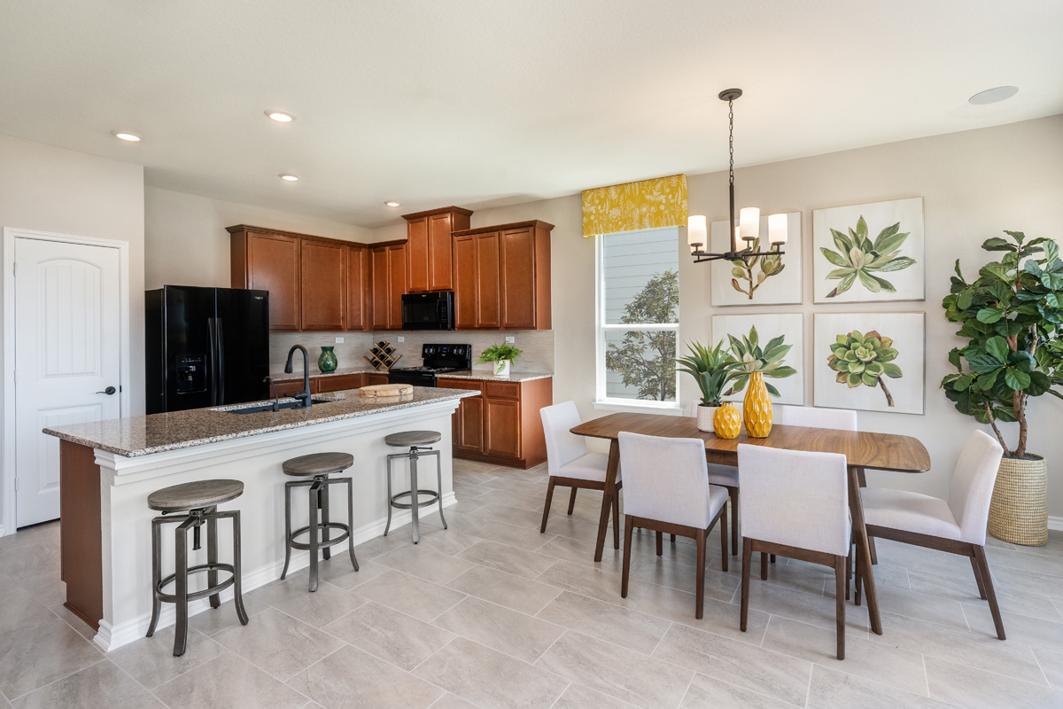 New Homes in New Braunfels, TX - Deer Crest - Classic Collection Plan 1675 Kitchen and Dining Area