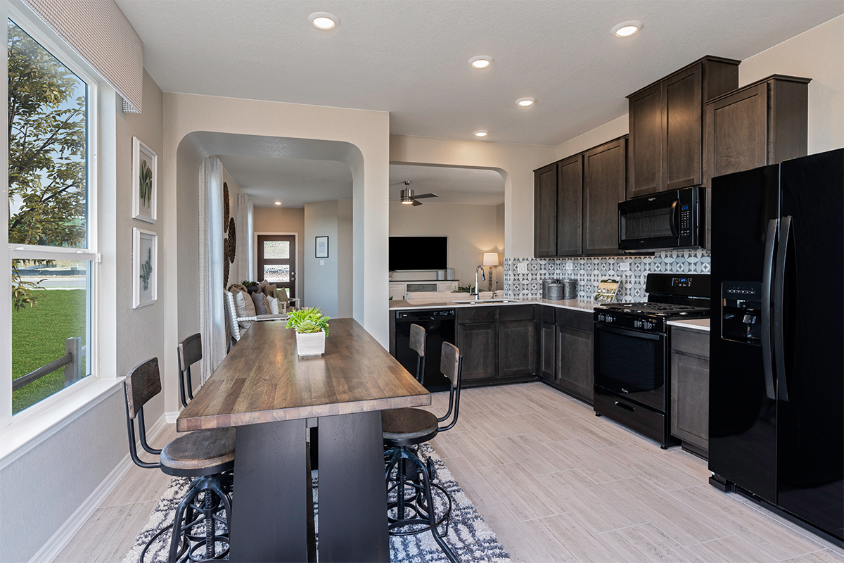 New Homes in Seguin, TX - Woodside Farms The 1516 Kitchen as modeled at Knox Ridge