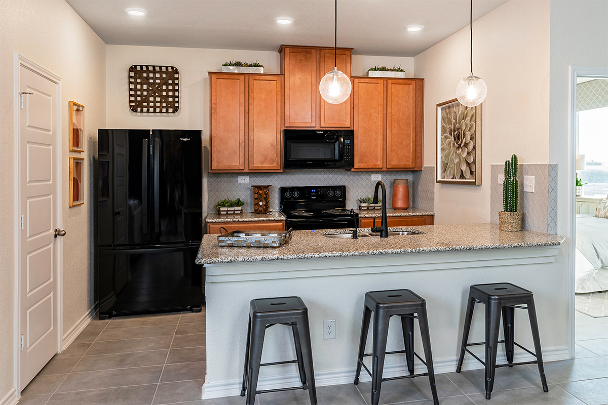 New Homes in Schertz, TX - Parklands The 1417 Kitchen as modeled at Marbella