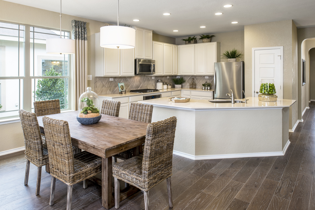 New Homes in New Braunfels, TX - Deer Crest - Classic Collection The 2004 Dining & Kitchen - As Modeled at The Ridge at Bandera